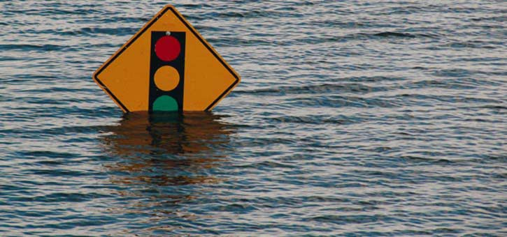 Floodwaters cover a sign during a hurricane.