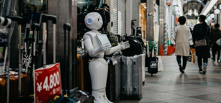 Using chatbots for customer service: a friendly robot helping bring customers into a store.drive