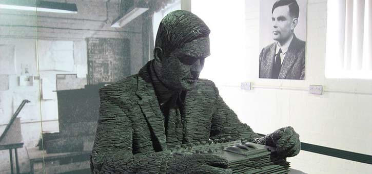 A sculpture of Alan Turing, who invented the chatbot or at least the concept of the chatbot, inside Bletchley Park.