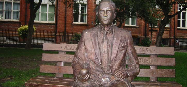 "A sculpture of Alan Turing titled ""Alan and the Apple."""