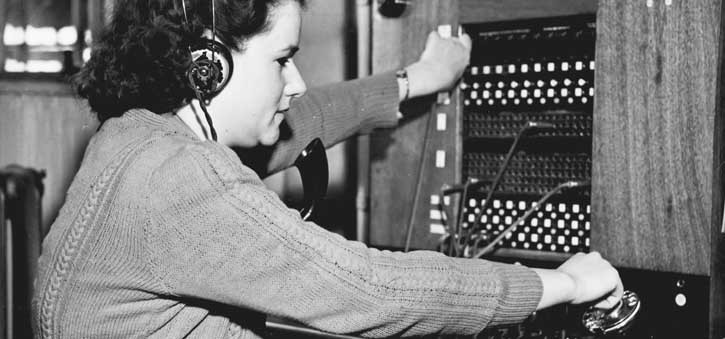 A phone operator redirecting calls in the days before Interactive Voice Response Systems.